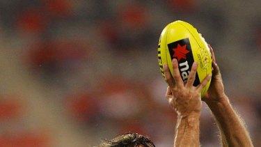 High-flyer: Geelong's Tom Hawkins marks during last night's clash with Goast Coast.