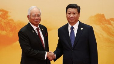 Najib Razak with China's President Xi Jinping  last year.