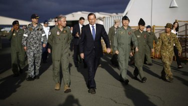 In step: Tony Abbott with Australian and international military personnel at RAAF Base Pearce during his Senate election campaign visit to Western Australia.