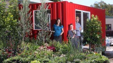 Showpiece: Jenny McCoy, Claire Farrell and John Rayner with a shipping container they are turning into a garden.