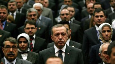 Man for the times ... Recep Tayyip Erdogan centre, among Justice and Development Party (AKP) members at a party meeting.