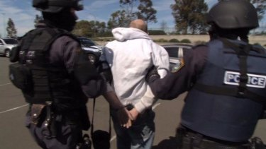 Busted: Police arrest a man in Sydney accused of making and supplying lethal pen guns.