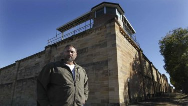 David Leha in front of the Parramatta Correctional Centre, will share his insights with young Victorians this week.