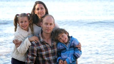 Happier times: Geoff Evans, who has post-traumatic stress disorder, with his wife Lisa and children Emily and Monash.