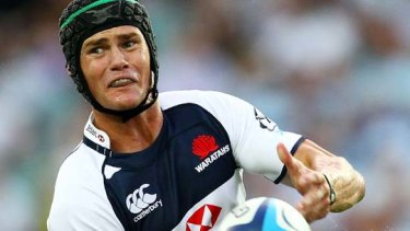 Berrick Barnes of the Waratahs has signed on with the ARU for two more seasons.