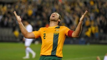 In happier times: Lucas Neill celebrates victory over Jordan in 2013 that took Australia to the brink of qualification for the 2015 World Cup.