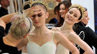 Ballerinas receive finishing touches to their make-up as the 50th anniversary season is revealed.