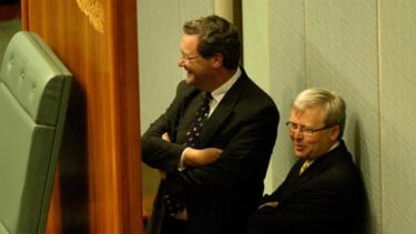 The then Foreign Affairs Minister, Alexander Downer, chats behind the speaker's chair in parliament with Kevin Rudd, then shadow foreign affairs spokesman.