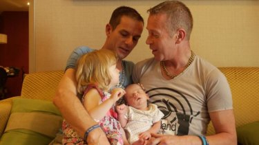 James, left, and Steven with Rhyley and two-year-old daughter Aleisha, in Bangkok.