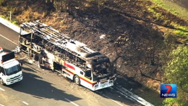 The bus fire also sparked a small grass fire on the side of the Warrego Highway. Photo: Seven News.