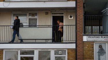 Police conduct house-to-house enquiries at neighbouring flats.