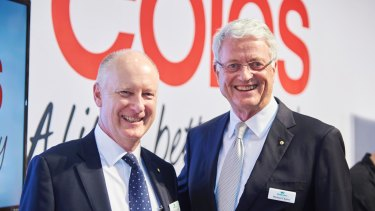 Michael Chaney (right) will hand over to Richard Goyder (left) as Woodside chairman.