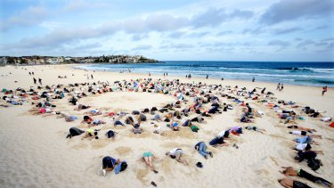 Bondi climate change protesters bury their heads in the sand ahead of the weekend's G20 meeting.