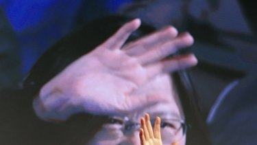 Taiwan's Democratic Progressive Party, DPP, presidential candidate, Tsai Ing-wen, raises her hands as she declares victory in the presidential election.