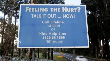 A Lifeline board at Kinglake spreads the help message.