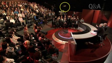 A screengrab of the shoe (circled) being thrown at former prime minister John Howard on <i>Q&A</i> last year.