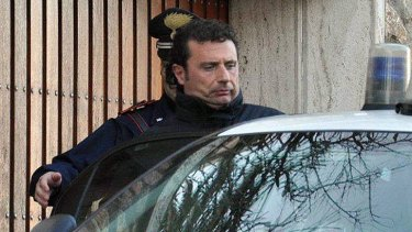 """""""Abandoned ship"""" ... Costa Concordia  captain Francesco Schettino is escorted away by police after his arrest."""