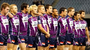 Storm players observe a minute's silence before unleashing their  power on the hapless Warriors. The huge crowd backed them all the way.