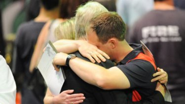 Mourners comfort each other at Rod Laver Arena.