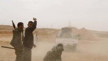Rebel fighters fire rockets southwest of Tripoli early last month.