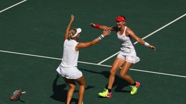Elena Vesnina and Ekaterina Makarova of Russia celebrate victory in the women's doubles gold medal match.