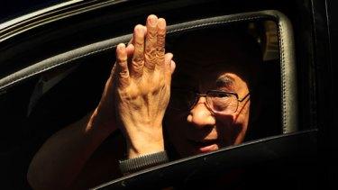 The Dalai Lama arrives at Parliament House.