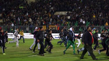 Pitch invasion ... fans ran on the field after the final whistle.