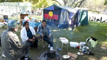 Eddie Pitt, Loulou Young and Christine Young sit in what is left of the Aboriginal Tent Embassy just outside Paniyiri, Australia's longest running Greek Festival held at Musgrave park in Brisbane, May 19, 2012.