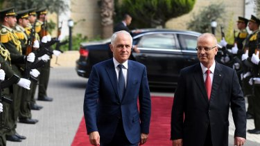 Malcolm Turnbull is escorted through the West Bank by Palestinian Prime Minister Rami Hamdallah on Wednesday. Turnbull said he doesn't support a citizenship audit.