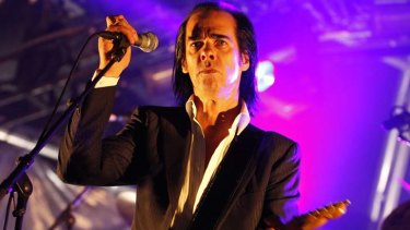 Nick Cave performs on stage.