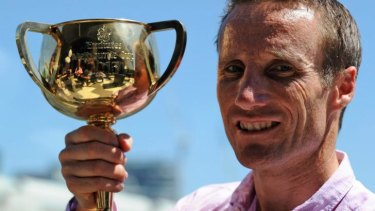 Flashback: Damien Oliver with the 2013 Melbourne Cup which he won on Fiorente.