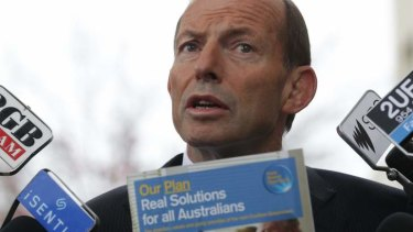 Opposition Leader Tony Abbott defends the existing 457 work visa system at Parliament House on Thursday.
