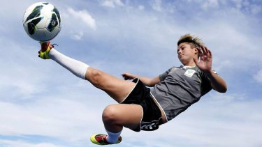 Michelle Heyman shows off her acrobatic skills before Canberra United training last night.