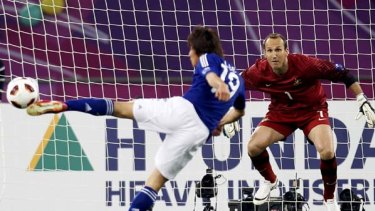 The winner . . . Tadanari Lee's rocket volley gave goalkeeper Mark Schwarzer no chance.