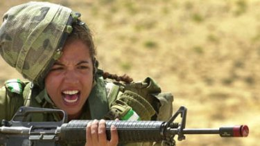 In a picture released by Israeli Defence Forces press office, an Israeli army female soldier shouts during a week-long survival course for women in the infantry at an undisclosed location in Israel May 23, 2005.