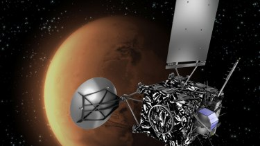 One-way ticket ... An artist's impression of the European Space Agency probe Rosetta with Mars in the background. Four people will be sent to the red planet in 2024 as part of the Mars One mission.
