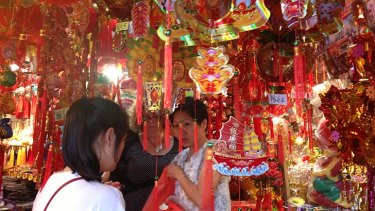 People shop in Chinatown ahead of Chinese New Year.