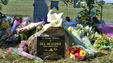 Sunshine bathes the memorial stone and the many flowers for Jill Meagher at Gisborne South yesterday.