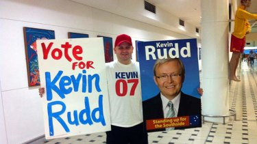 Supporter: ALP member Brad Newman waits for Kevin Rudd to arrive at Brisbane Airport.