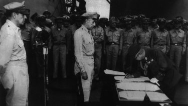 Japanese General Yoshijiro Umezo, Chief of the Imperial Staff, signs Japan's surrender documents on September 1, 1945 aboard the USS Missouri.
