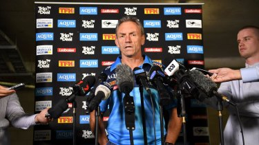 Questions: Gold Coast Titans coach Neil Henry fronts the media.