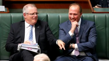 Treasurer Scott Morrison and Minister for Immigration and Border Protection Peter Dutton during question time at Parliament House.