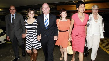Campbell Newman arriving at the Hilton Hotel with his family.