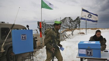 Walkover...an Israeli soldier cast a prepoll vote at a military outpost in the Golan Heights on Monday.
