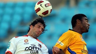 Brisbane Roar's Thomas Broich and Robson Gold Coast United compete for the ball when the sides met earlier this season.