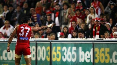 Shattered: Adam Goodes points to his abuser during Friday night's match against Collingwood.