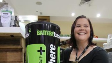Atomik Green staffer Courtney Lewis with the BatteryBack bin.