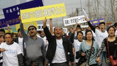 Outpouring of anger: relatives of missing MH370  passengers protest.