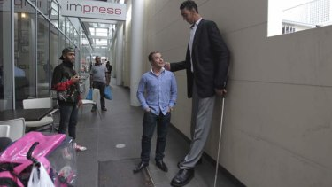 Sultan Kosen, the world's tallest man, meets Mikail Alkin, who is 169cm, in Auburn on Friday.