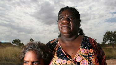 Yapa Yapa traditional owner Dianne Stokes, with daughter Sky, wants answers from government over plans to build a waste dump near Tennant Creek, Northern Territory.